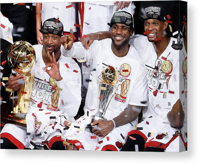 Playoffs Canvas Print featuring the photograph Dwyane Wade, Chris Bosh, and Lebron James by Kevin C. Cox
