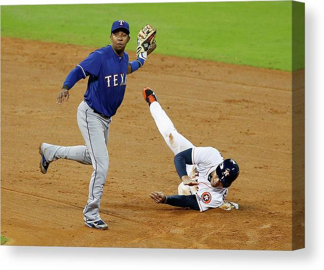 American League Baseball Canvas Print featuring the photograph Elvis Andrus and George Springer by Scott Halleran