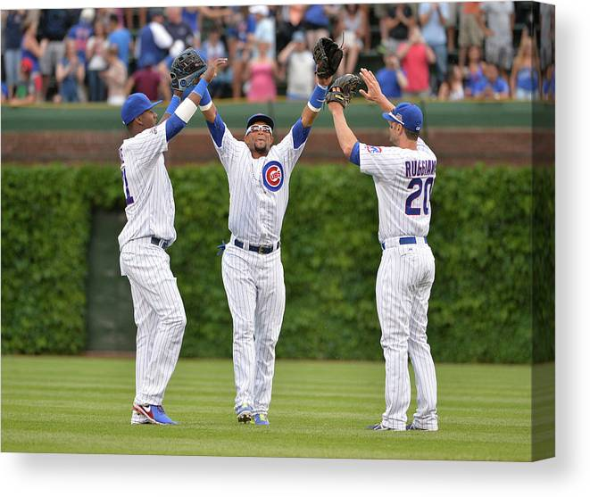 Celebration Canvas Print featuring the photograph Emilio Bonifacio and Justin Ruggiano by Brian Kersey