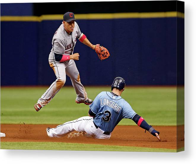 Following Canvas Print featuring the photograph Evan Longoria and Asdrubal Cabrera by Mike Carlson