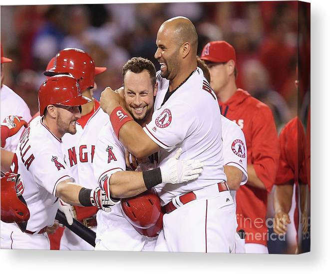 Ninth Inning Canvas Print featuring the photograph Johnny Giavotella, Albert Pujols, and Daniel Nava by Stephen Dunn