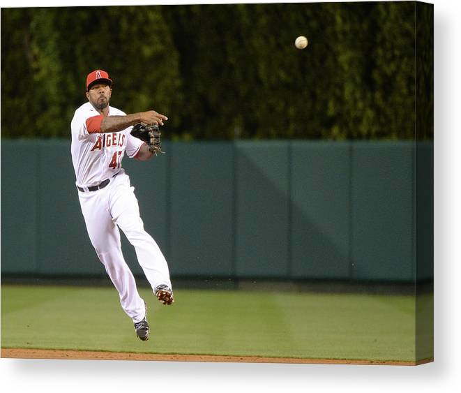 Second Inning Canvas Print featuring the photograph Justin Smoak and Howie Kendrick by Harry How