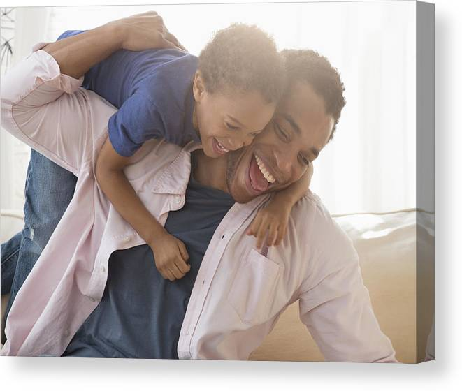 4-5 Years Canvas Print featuring the photograph Mixed race father and son playing on sofa by Jose Luis Pelaez Inc