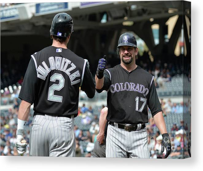 People Canvas Print featuring the photograph Todd Helton and Troy Tulowitzki by Denis Poroy