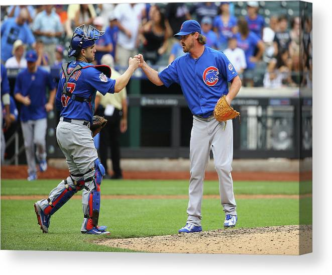 People Canvas Print featuring the photograph Travis Wood and Miguel Montero by Al Bello