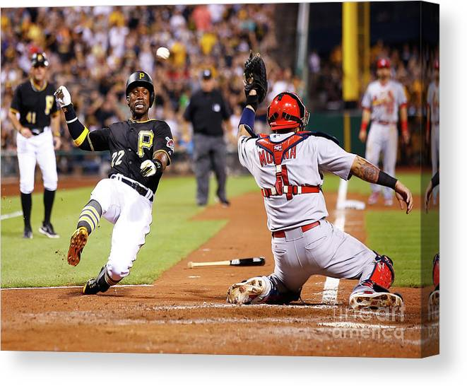 St. Louis Cardinals Canvas Print featuring the photograph Yadier Molina and Andrew Mccutchen by Jared Wickerham
