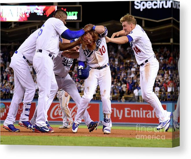 Ninth Inning Canvas Print featuring the photograph Yasiel Puig and Justin Turner by Harry How