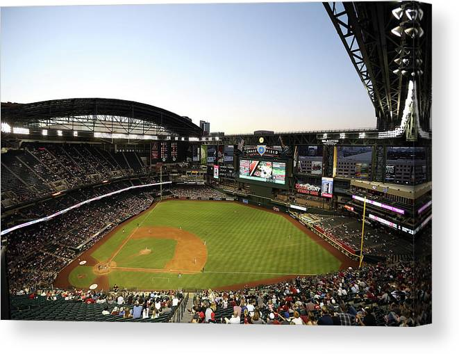 Motion Canvas Print featuring the photograph Colorado Rockies V Arizona Diamondbacks by Christian Petersen