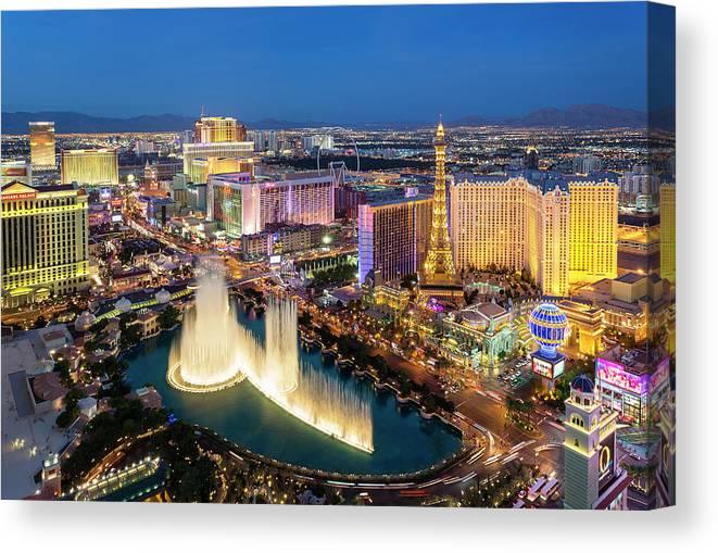 Las Vegas Replica Eiffel Tower Canvas Print featuring the photograph Las Vegas Skyline At Dusk by Sylvain Sonnet