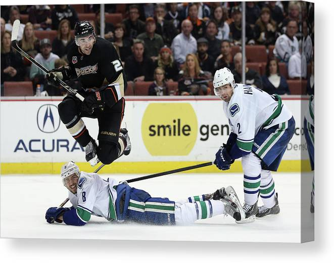 National Hockey League Canvas Print featuring the photograph Vancouver Canucks V Anaheim Ducks by Jeff Gross