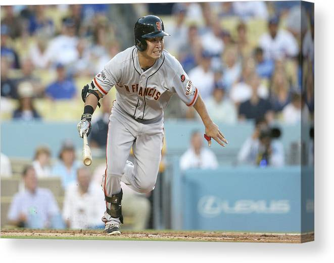 People Canvas Print featuring the photograph San Francisco Giants V Los Angeles by Stephen Dunn