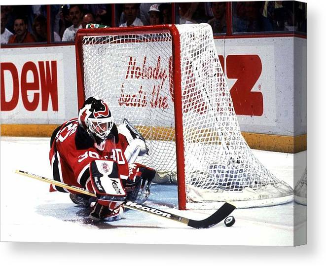 National Hockey League Canvas Print featuring the photograph Brodeur stops Flyers by B Bennett