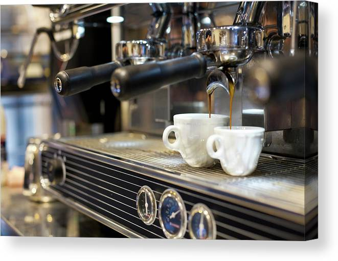 Making Canvas Print featuring the photograph Espresso Machine Pouring Coffee Into by Kathrin Ziegler