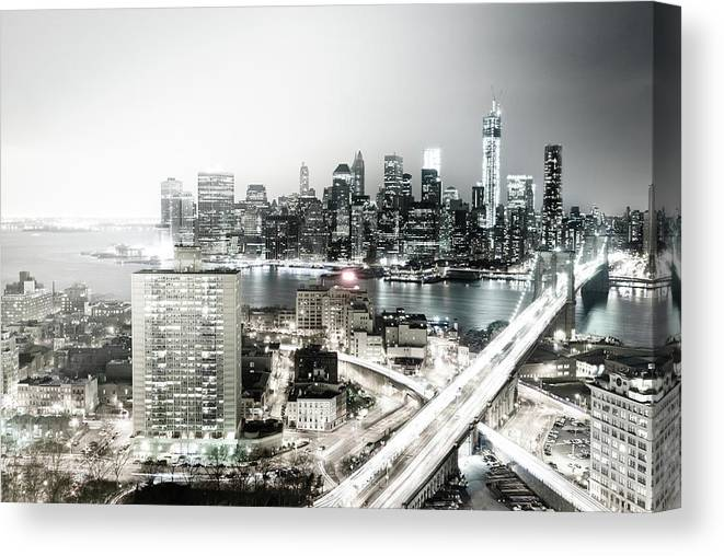 Lower Manhattan Canvas Print featuring the photograph New York City Skyline At Night by Mundusimages