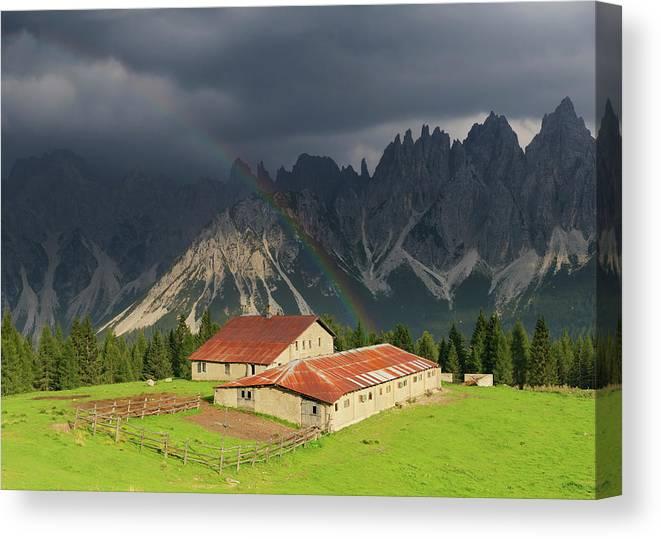 Belluno Canvas Print featuring the photograph Rainbow Over Casera Vedorcia Dolomites by Albertosimonetti