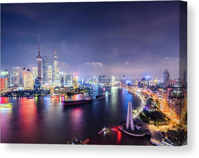Downtown District Canvas Print featuring the photograph Shanghai Skyline At Night by Yongyuan Dai