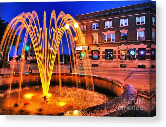 Menasha Canvas Print featuring the photograph Menasha Lighted Fountain by Ever-Curious Photography