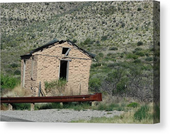 Stucco Building Canvas Print featuring the photograph Abandoned Stucco Building Alongside Roadside  by Colleen Cornelius