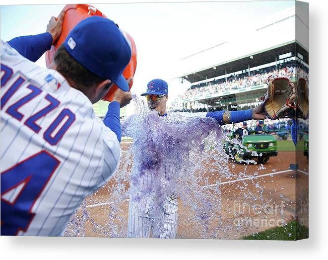 Following Canvas Print featuring the photograph St Louis Cardinals V Chicago Cubs by Nuccio Dinuzzo