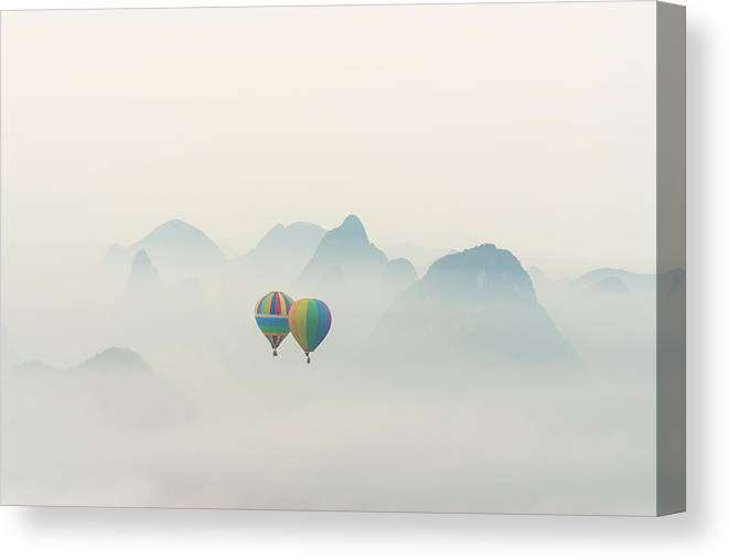 Scenics Canvas Print featuring the photograph Hot Air Balloon Ride At Dawn Over Karst by Alex Linghorn