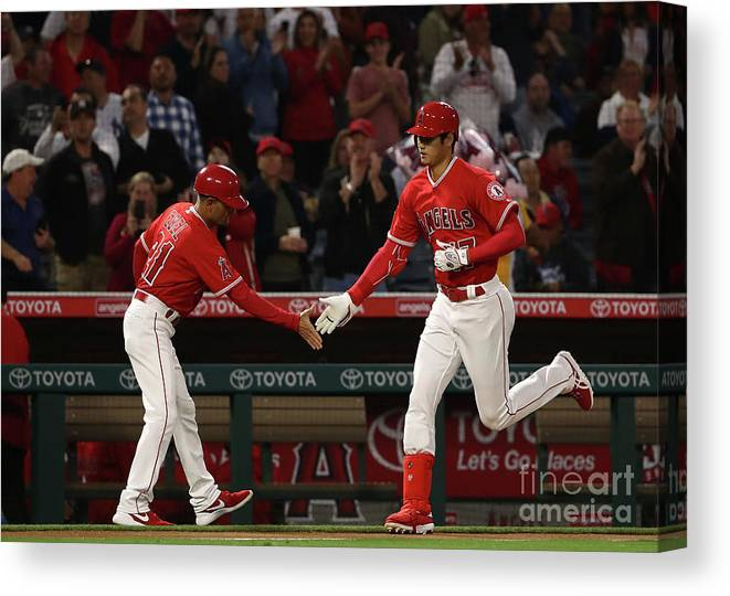 Second Inning Canvas Print featuring the photograph New York Yankees V Los Angeles Angels by Victor Decolongon