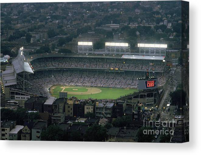 1980-1989 Canvas Print featuring the photograph Wrigley Field by Jonathan Daniel
