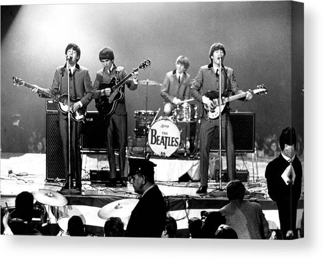Rock Music Canvas Print featuring the photograph Beatles Perform In Washington, D.c by Michael Ochs Archives