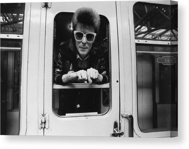 David Bowie Canvas Print featuring the photograph Bowie On The Rails by Smith