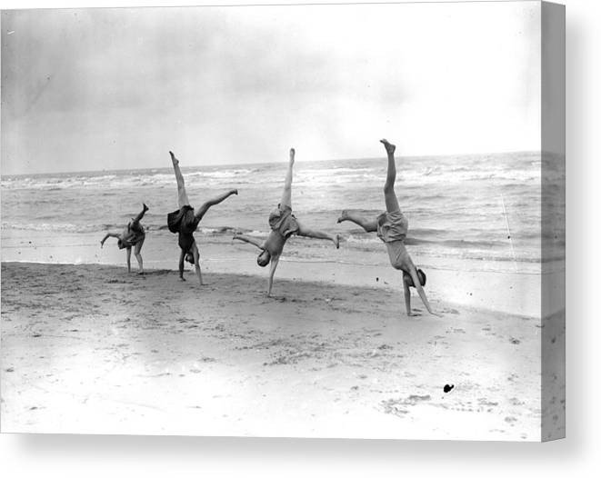 People Canvas Print featuring the photograph Cartwheels by Fox Photos