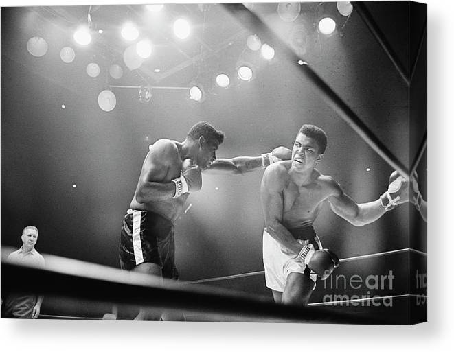Snarling Canvas Print featuring the photograph Cassius Clay Snarling At Floyd Patterson by Bettmann