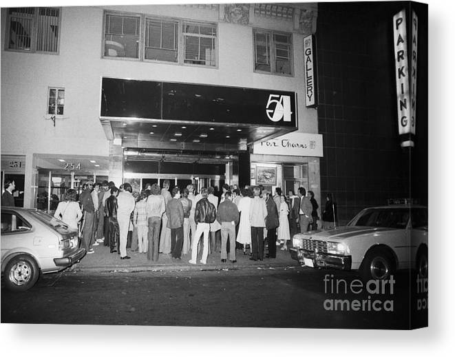 Crowd Of People Canvas Print featuring the photograph Crowd Standing In Front Of Studio 54 by Bettmann