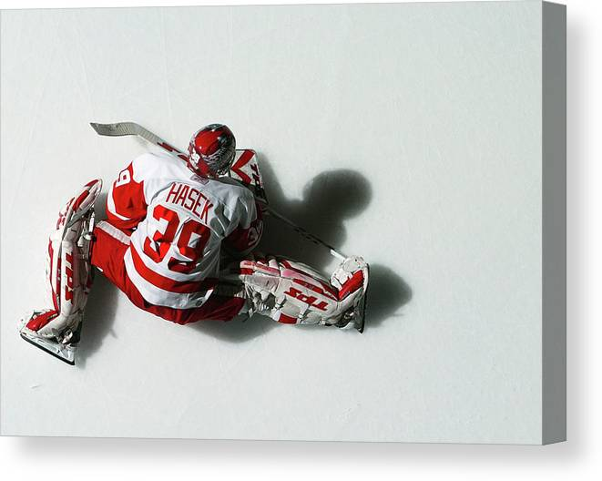 National Hockey League Canvas Print featuring the photograph Detroit Red Wings V New York Islanders by Al Bello