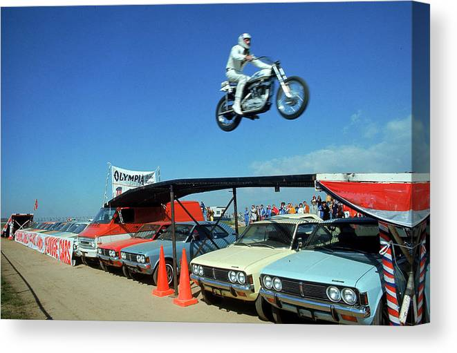 Timeincown Canvas Print featuring the photograph Evel Knievel In Flight by Ralph Crane