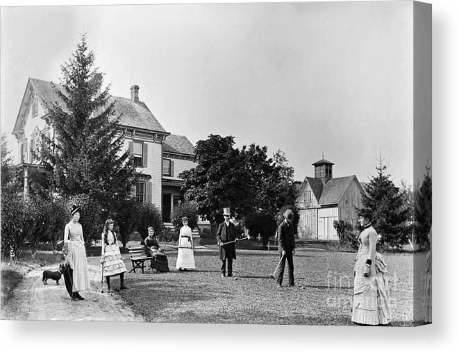 People Canvas Print featuring the photograph Family Plays Croquet In Front Of Home by Bettmann