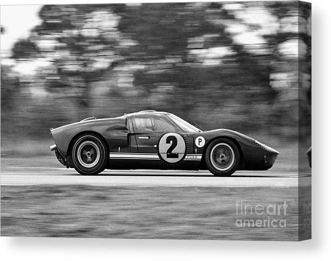 People Canvas Print featuring the photograph Ford Prototype Racecar On Track by Bettmann