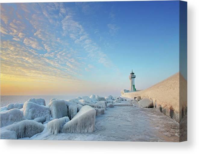 Dawn Canvas Print featuring the photograph Frozen Lighthouse by Sandra Kreuzinger