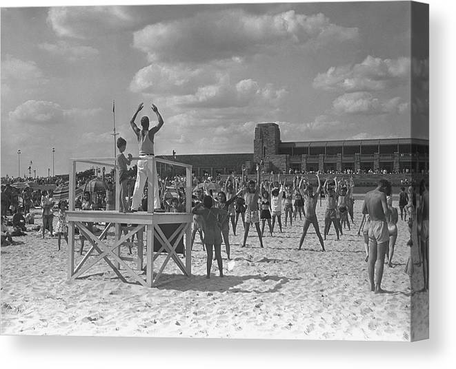 Human Arm Canvas Print featuring the photograph Group Of People Exercising On Beach, B&w by George Marks