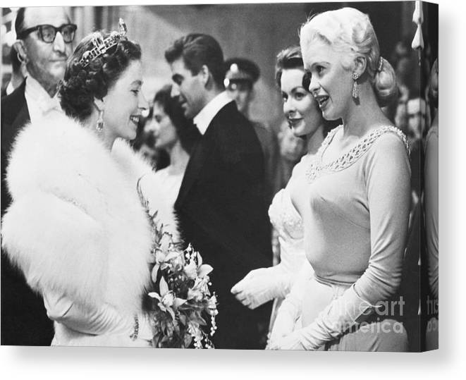 Royal Film Performance Canvas Print featuring the photograph Jayne Mansfield Meeting Queen Elizabeth by Bettmann