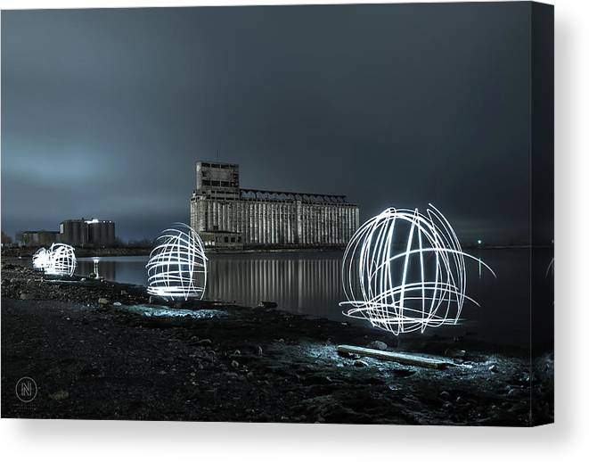Galagher Pier Canvas Print featuring the photograph Lights in the Night by Dave Niedbala