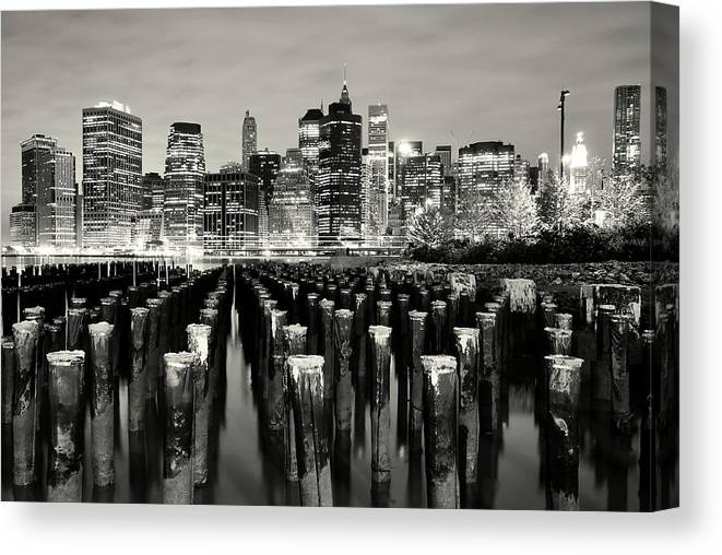 Wooden Post Canvas Print featuring the photograph Manhattan At Night by Shobeir Ansari