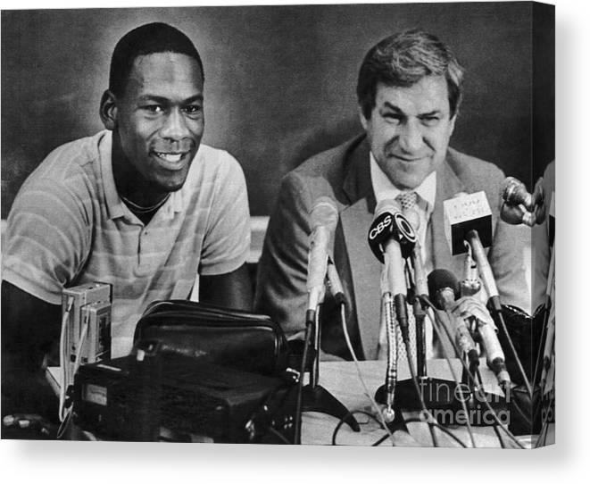1980-1989 Canvas Print featuring the photograph Michael Jordan And Coach Dean Smith by Bettmann