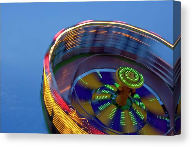 Carousel Canvas Print featuring the photograph Multicolored Spinning Carnival Ride by By Ken Ilio