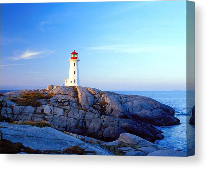 Water's Edge Canvas Print featuring the photograph Peggys Cove Lighthouse At Sunrise by Photorx