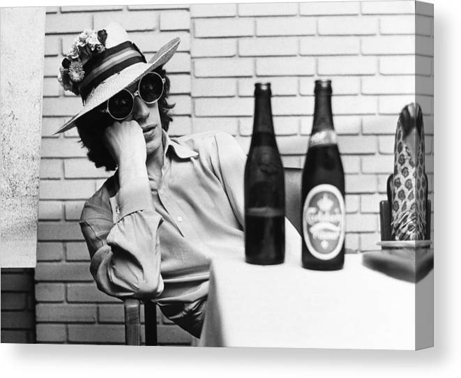 Mick Jagger Canvas Print featuring the photograph Portrait Of Mick Jagger With A Sun Hat by Keystone-france