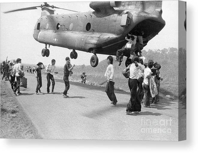 Following Canvas Print featuring the photograph Refugees Hanging On To A Supply by Bettmann