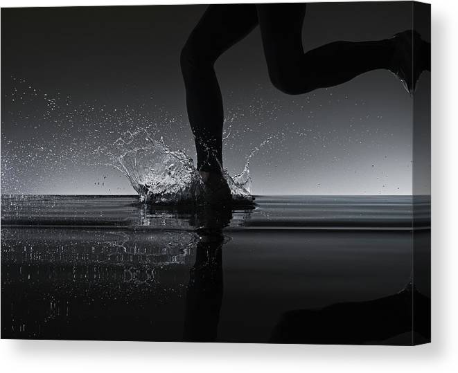 Recreational Pursuit Canvas Print featuring the photograph Running Through Water by Jonathan Knowles