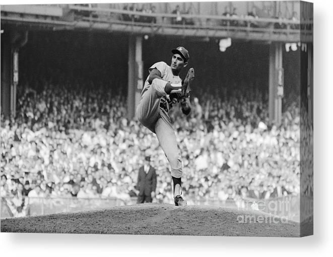 Sandy Koufax Canvas Print featuring the photograph Sandy Koufax Throwing Pitch In World by Bettmann