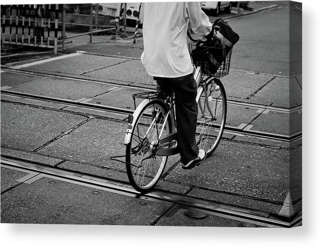 Child Canvas Print featuring the photograph Schoolboy Bicycling Across Railroad by Hedgy Nathan Wright
