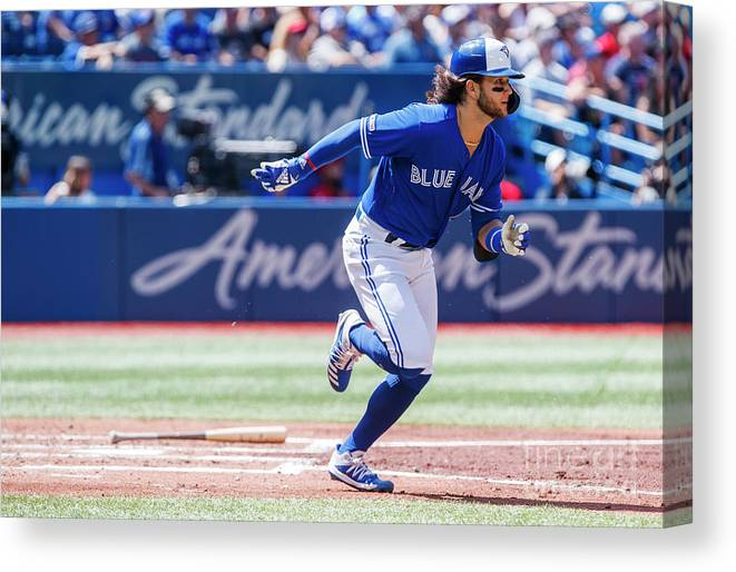 People Canvas Print featuring the photograph Seattle Mariners V Toronto Blue Jays by Mark Blinch