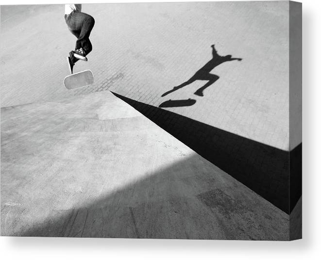 Shadow Canvas Print featuring the photograph Shadow Of Skateboarder by Mgs